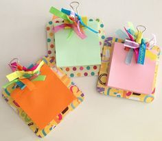 Mini clipboards to hold sticky note pads made out of coasters.