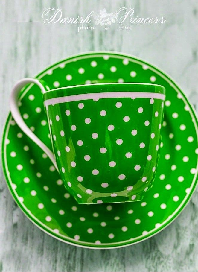 Green and white spotted cup and saucer
