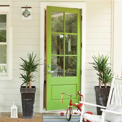 Great slideshow of front door paint ideas, complete with names and links of paint colors. This green one is my favorite.