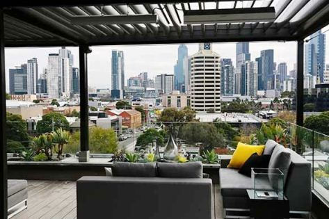 A great use of HEATSTRIP Max outdoor heaters on a rooftop terrace.