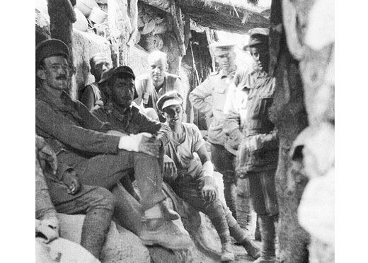Australian soldiers relax in the trenches at Lone Pine on 10 August 1915, the day after the end of the battle. Notice the pine logs roofing the trench. Some of these were broken open by the Anzac bombardment of the Turkish trenches on 6 August and in the initial attack at 5.30 pm some Australian soldiers jumped through these holes into the Turkish positions. Others entered the Turkish front line through gaps that had been left in this head cover. At that stage, fortunately for them, many…