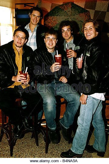 Take That pop group members are Robbie Williams Jason Orange Gary Barlow Mark Owen and Howard Donald at Planet Hollywood - Stock Image