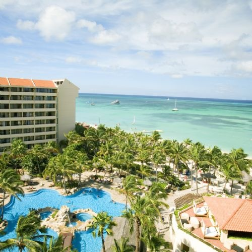 Occidental Grand Aruba. The Occidental Grand Aruba is a lively, all-inclusive resort set on a beautiful stretch of white-sand beach within a grove of gently swaying palm trees