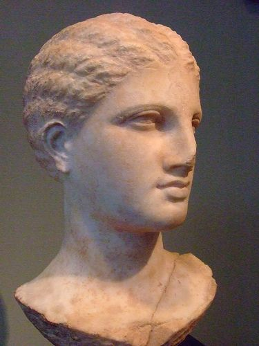 Head of a Young Unmarried Woman from a Greek Grave Monument with a melon-coiffure made in Athens about 320 BCE Marble