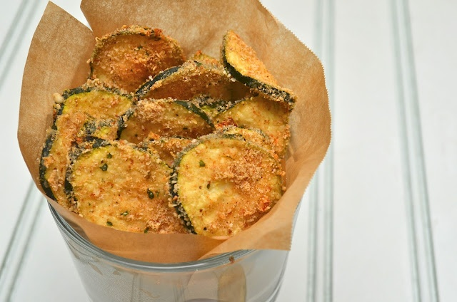 Zucchini Oven Chips  Servings: 4    Ingredients  1/4 cup dry whole wheat breadcrumbs  1/4 cup (1 ounce) grated fresh Parmesan cheese   1/4 tsp seasoned salt   1/4 tsp garlic powder  1/8 tsp freshly ground black pepper  2 tbsp low-fat milk (or almond milk)  2 1/2 cups (1/4-inch-thick) slices zucchini (about 2 small)   Cooking spray     Preheat oven to 425°.  Combine first 5 ingredients in a medium bowl, stirring with a whisk. Place milk in a shallow bowl. Dip zucchini slices in milk, and dred...