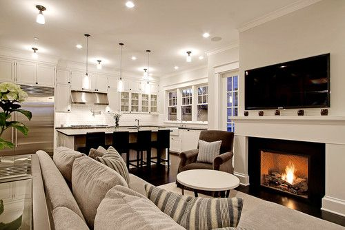 Kitchen - traditional - living room - seattle - by Paul Moon Design. Open floor plan with white kitchen and cozy fireplace.