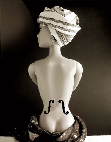French artist Jocelyne Grivaud's Barbie interpretation of a Man Ray (1890 - 1976) photograph.