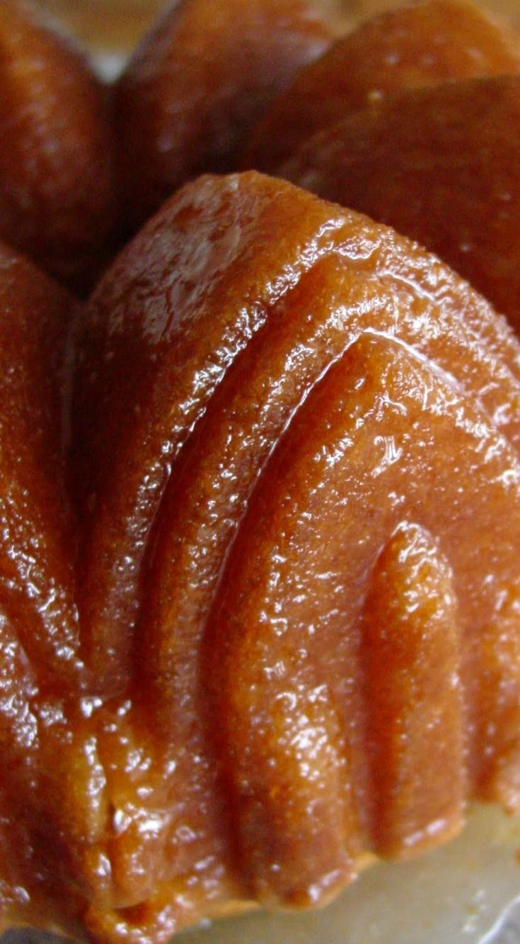 Golden Rum Cake ~ It's simple and delicious, but it's the glaze that's the star... You brush the rummy glaze on and it soaks into the cake. When it sets, it turns to a flaky buttery crust- almost like a glazed cake donut...but better!