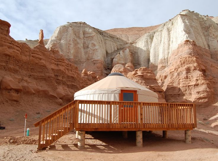 Wake up in a yurt at Goblin Valley State Park surrounded by hoodoos, nooks, and canyons to explore.