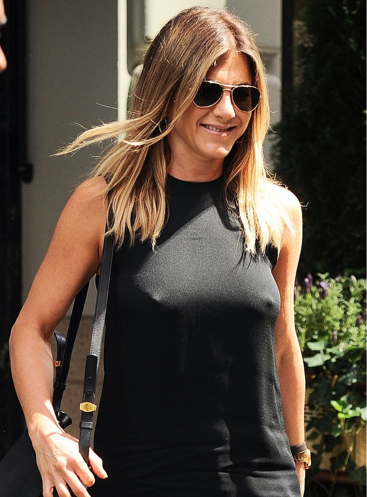 Jennifer aniston ditches the bra and shows off nipples in sheer dress