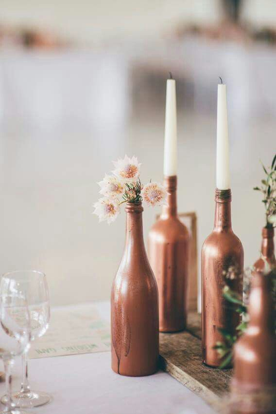 You don't have to go expensive with your decor.  Make use of what you have at home.  I sprayed my bottels copper,  added candles and just rounded them off with a flower here and there