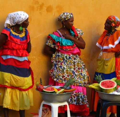 Cartagena Colombia.. My Palenqueras. They sell fresh fruit and local sweets. Love them. They have a heart as colorful as their outfit.