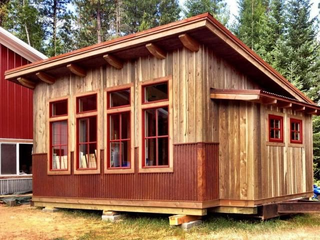 Rustic style little cabin with huge windows to help me appreciate the amazing views I have from my property