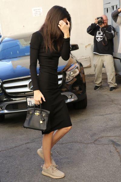 | Kendall Jenner | sleek black dress and sneakers