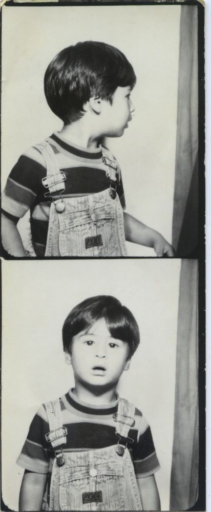 Vintage photo booth portrait. CONFUSED YOUNG BOY.