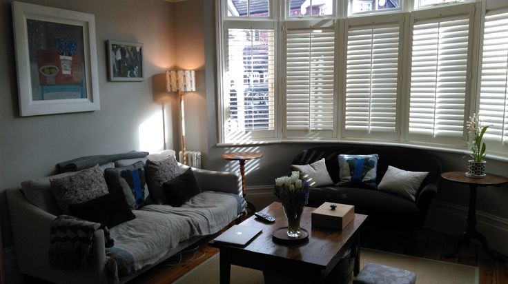 edwardian sitting room round bay shutters