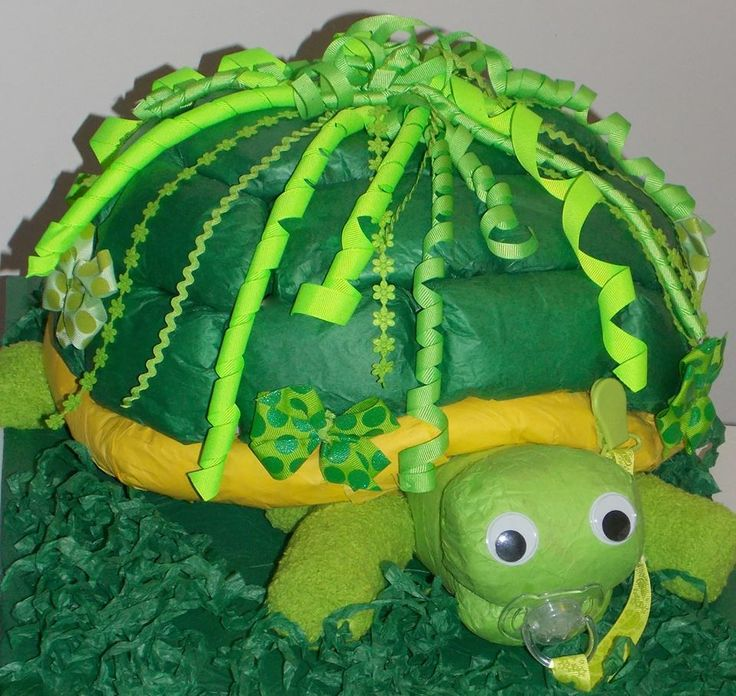 turtle DIAPER cake 96 diapers, 2 pair fuzzy socks, 1 paci & paci clip Www.facebook.com/glittersticks