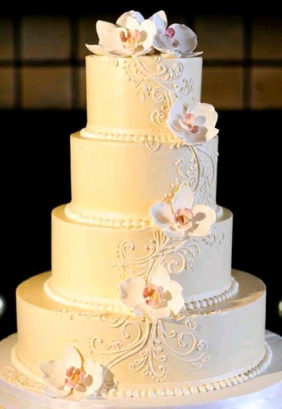 A pretty white wedding cake with flowers made of sugar.