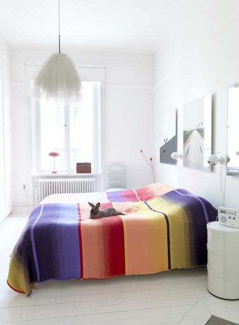 It's amazing how spectacular bedding can add to a simple bedroom. The bunny on the bed is a big win too. ;)