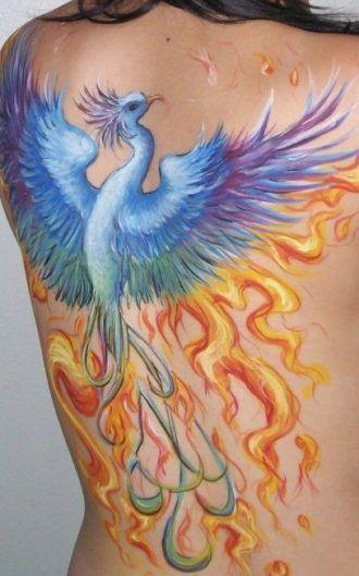 splendid blue phoenix in fire tattoo on back