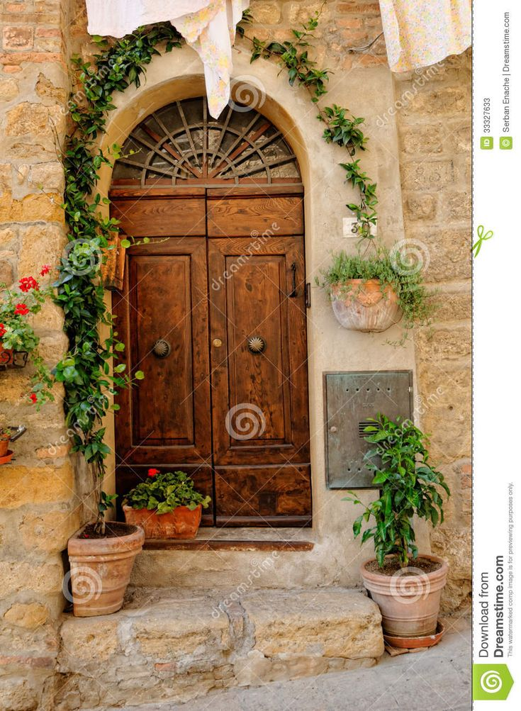 Tuscan Doors Decorative Wooden Door To A Stone House Or