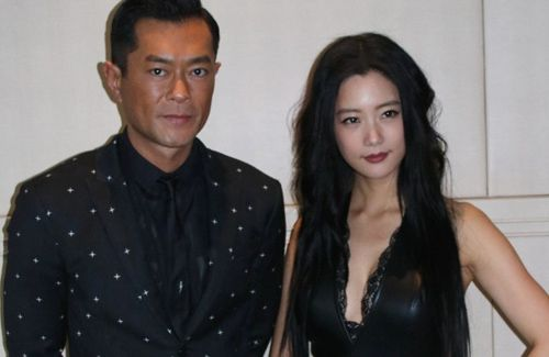 "Louis Koo and Korean star, Clara Lee, film an action scene for the ""Line Walker"" movie."
