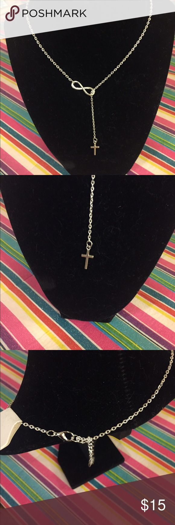 NWT infinity cross necklace (2) available-  silver toned necklace with cross through the infinity symbol. Very pretty. Jewelry Necklaces