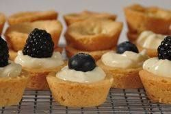 These rich and buttery miniature shortbread tarts are filled with a delicious cream filling made with cream cheese, condensed milk and lemons. Garnish with fresh berries. From Joyofbaking.com With Demo Video: Tea Party, Recipe, Sweet, Cream Cheese, Tea Parties, Cream Filling, Shortbread Tarts, Dessert, Mini Tart
