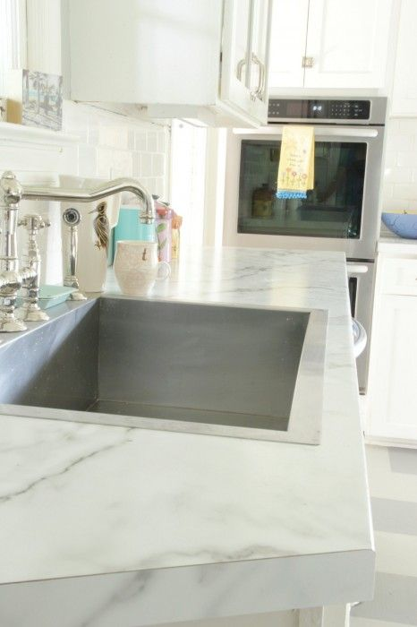 KITCHEN MAKEOVER - COUNTER TOPS - Calacatta marble in Formica 180x...a viable alternative to breaking the bank...and a way to buy time if yo are trying to stretch your decorating dollars. AND it LOOKS AMAZING!