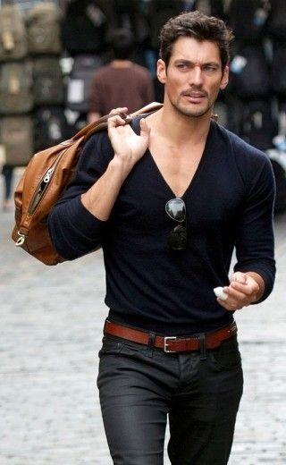 David Gandy V-neck sweater with belt and fitted slacks with bag
