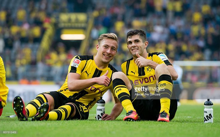 Felix Passlack and Christian Pulisic of Borussia Dortmund celebrates after the Bundesliga match between Borussia Dortmund and SV Darmstadt 98 at Signal Iduna Park on September 17, 2016 in Dortmund, Germany.