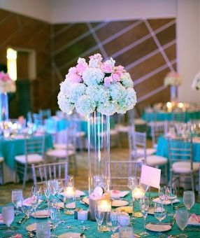 Tiffany blue uplighting with a nice tall centerpiece. @Lauren ...