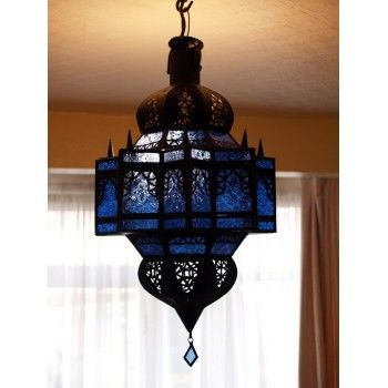 Moroccan Lantern - ML1 Blue£ 60.00 Moroccan lantern with blue panels in a dark coloured frame. The metal frame has been perforated in a traditonal Moroccan style to create a very effective diffusion of light when the lantern is lit. Approx Length: 55 cm