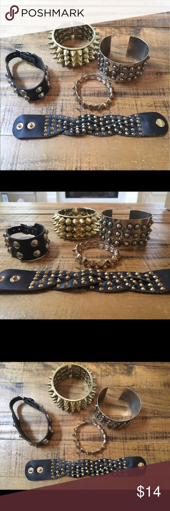 Spiked and studded bracelet collection Collection includes:  1.  Silver metal gauntlet with metal spikes.  2. Gold colored plastic spiked gauntlet, in excellent condition with only slight wear at the edges of some of the spikes. 3. Goldtone single row Metal spikes on an elastic cord.  4. Vintage black woven leather snap closure bracelet with small metal gold tone studs. 5. Faux leather two row studded bracelet with watch strap style closure. Faux leather is cracked and loosening slightly…