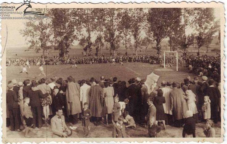 Wisła Kraków play Cracovia in 1943 as part of the Second World War Kraków underground football league.  The match was played in the Kraków suburb of Łagiewniki
