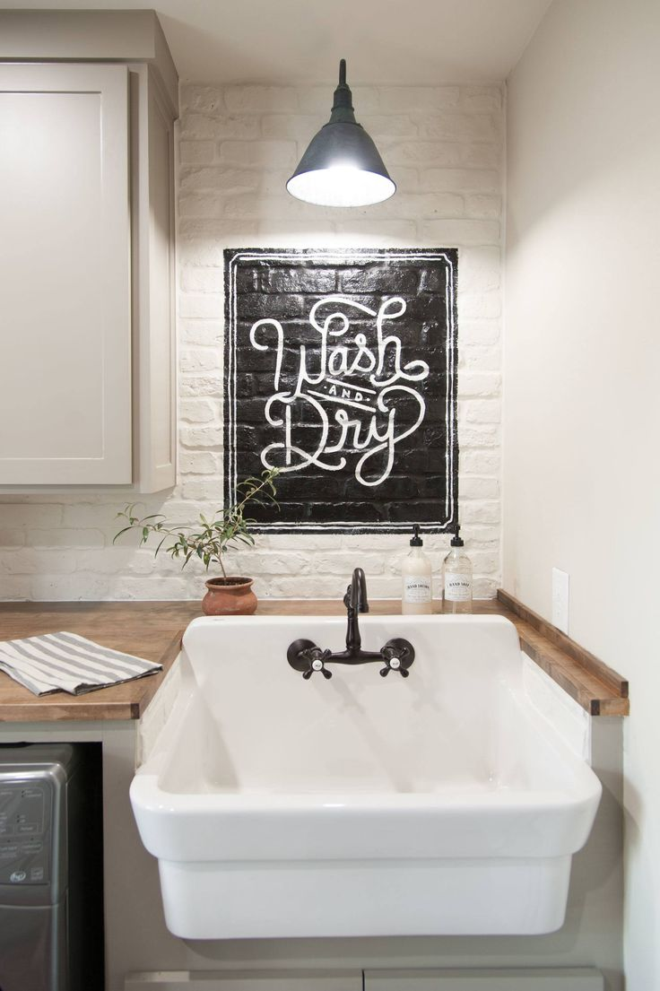 This laundry mural was from the Ignacio project. It's quite a bit smaller than the Graham mural, but I love the character that painting it on brick gave it. -Fixer Upper
