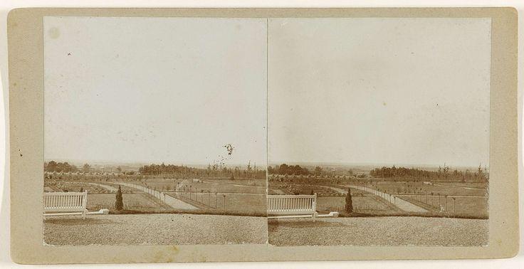 E. ten Cate | Uitzicht met witte bank, E. ten Cate, 1908 - 1914 | Uitzicht op een grote tuin of park met kleine boompjes langs lanen. Links op de voorgrond een witte bank.