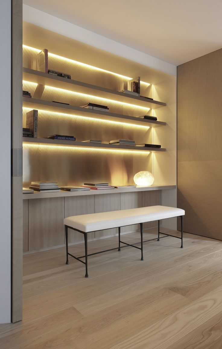 Clean American White Ash with Natural White Oil - running from floor to back-lit shelving unit. #shelves #covelighting
