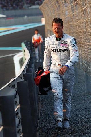 Michael Schumacher (GER) Mercedes GP walks in after crashing.  Formula One World Championship, Rd 19, Abu Dhabi Grand Prix, Race, Yas Marina Circuit, Abu Dhabi, UAE, Sunday, 14 November 2010