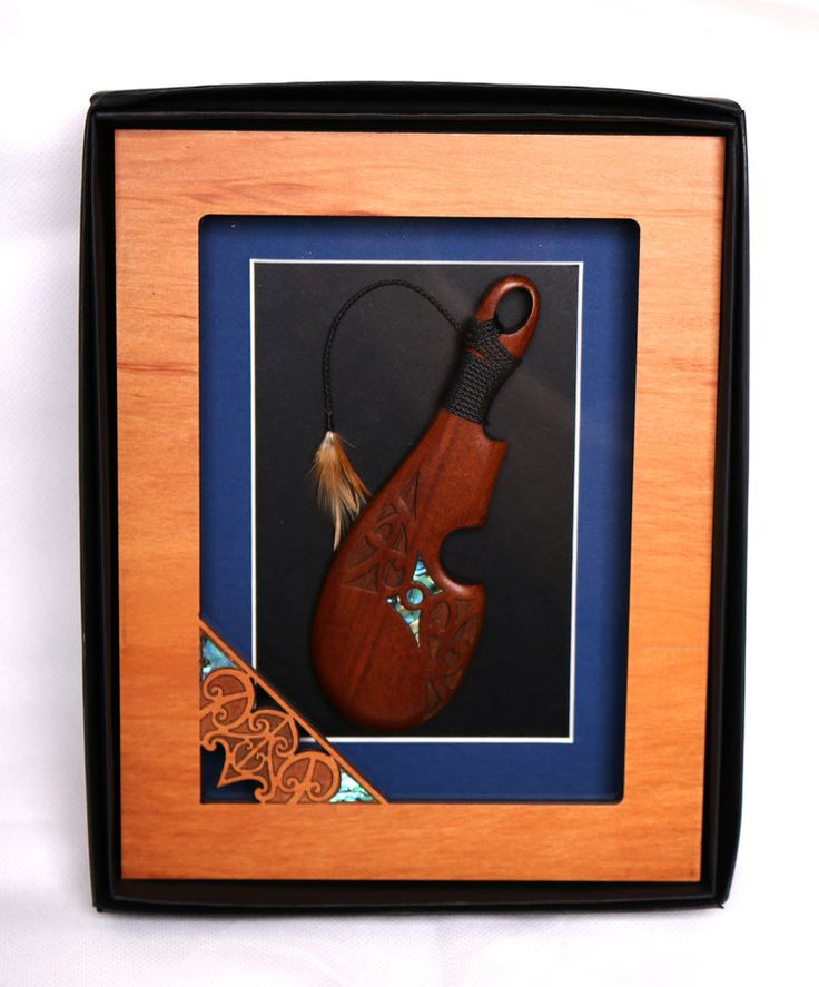 Perfect for a corporate gift. Framed wooden carving.