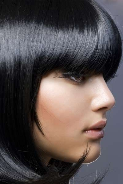 Bangs and bobs are the perfect pairing, especially for lustrous thick hair. This demi bob that hits somewhere between the chin and shoulder is a great example. Ends are cut at an angle to encourage natural curl