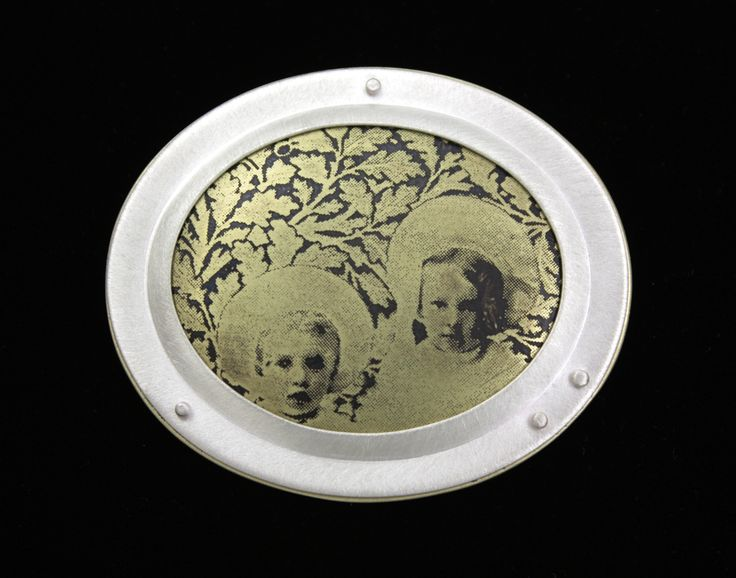 Etched vintage photograph on brass, sterling setting.