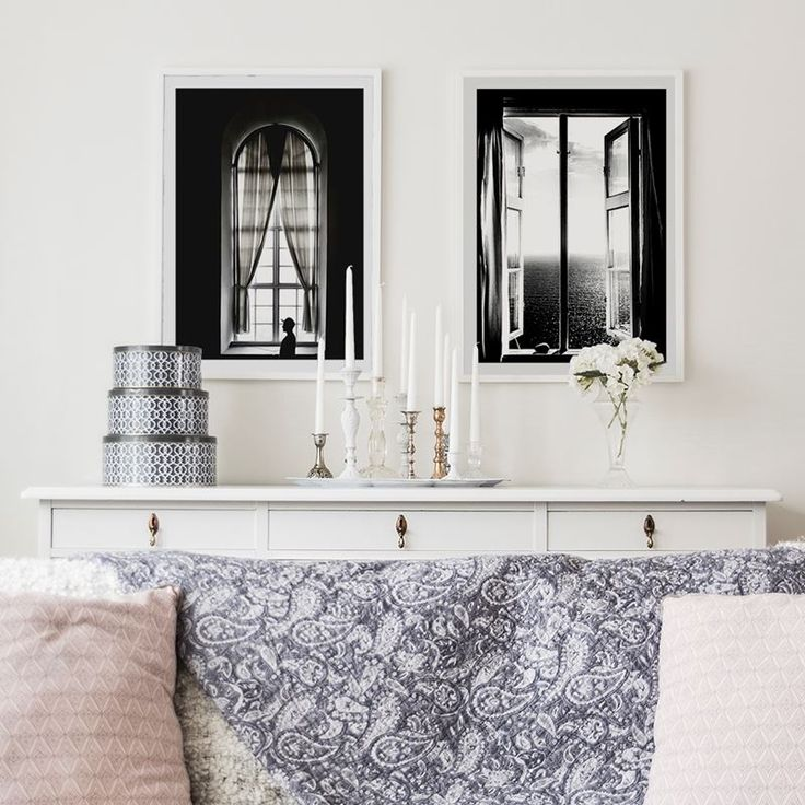 Light and soft living room with patterns and pastel, and black and white framed posters of windows from printler.com, the marketplace for photo art. Motifs by Cim Ek and Annika Öhman