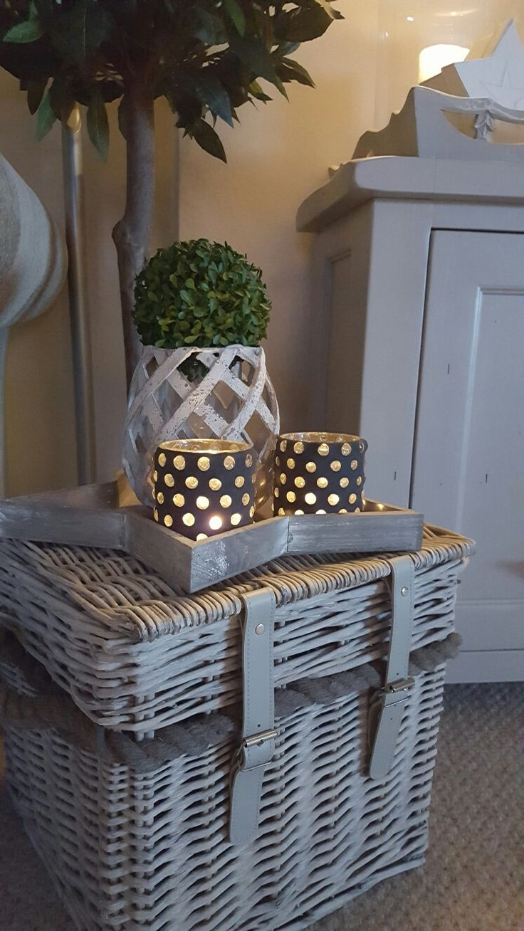 Wicker trunk makes a perfect side table... Wicker Candle holders