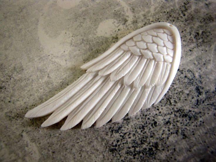 Carved Bone Wing Pendant 60mm.