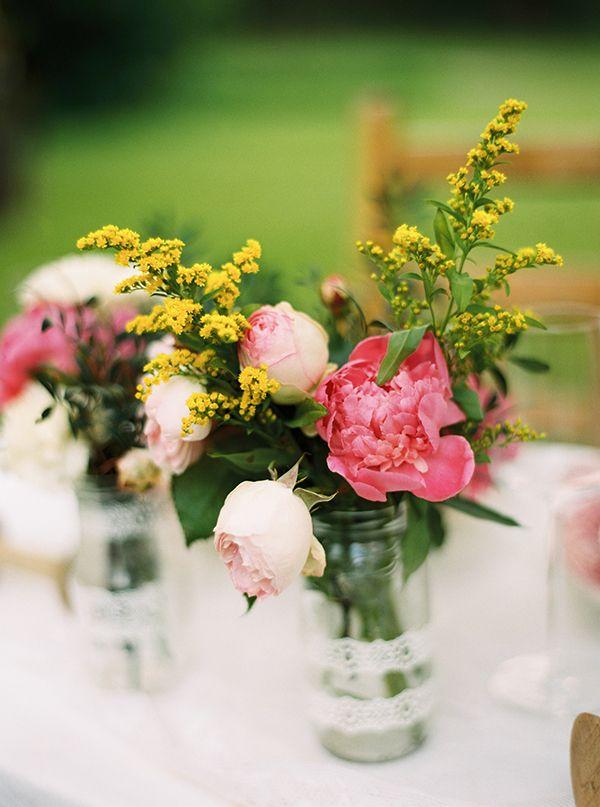 floral centerpiece ideas http://www.weddingchicks.com/2013/09/12/rustic-after-the-wedding-shoot-ideas/