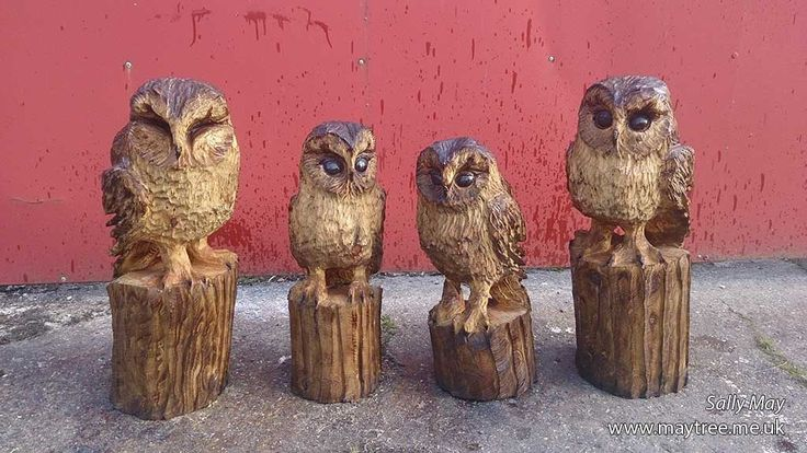 A row of tawny owl chainsaw carvings