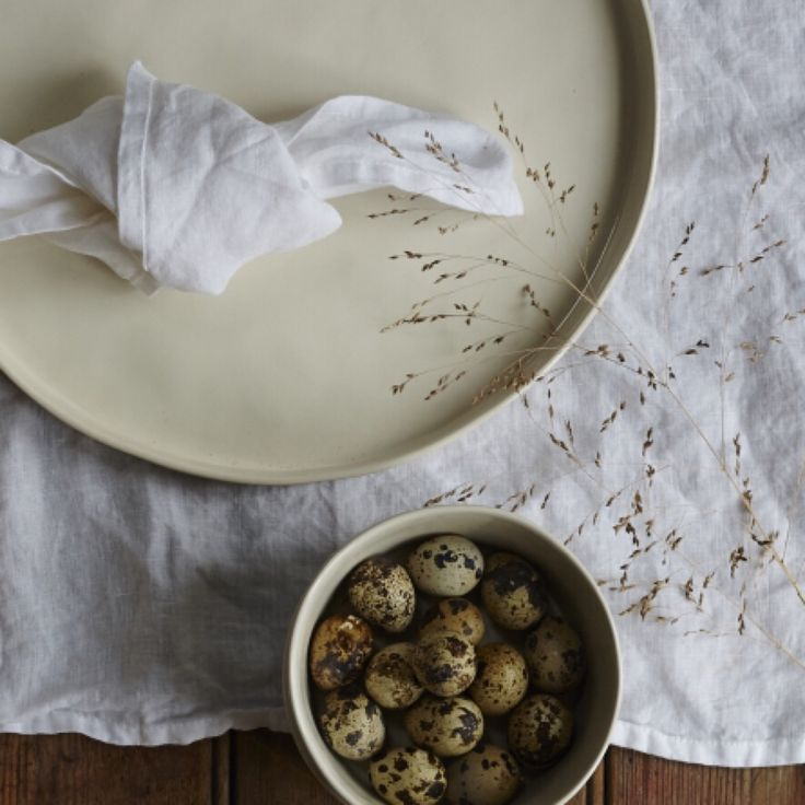 Soft white linen napkins and tablecloths and our Kuro Scandinavian inspired ceramics - stylish, simple and elegant.  www.alsohome.com/  #scandinaviandesign #ceramics #linen #dining #tableware #natural #white #rustic #homeswithmeaning #alsohomeuk