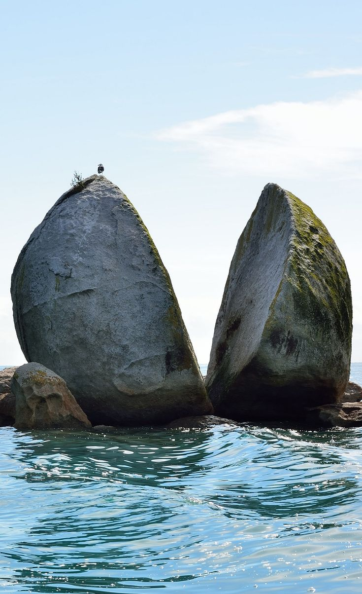 Split Apple Rock, (Kaiteriteri, S Island, NZ) is a geological rock formation in the Tasman Bay made of granite. The cleft to produce 2 sides of the 'apple' was a natural occurrence. It is unknown when this happened & the cleaving of the rock has attracted mythological explanations