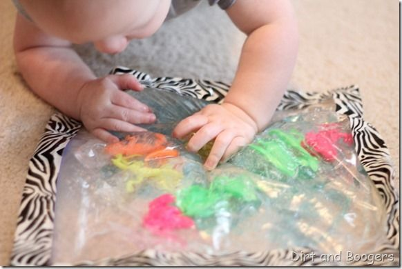 This is great i just need to figure ou a heavy plastic since my baby would bite through. Baby Sensory Bag: probably the best baby toy ever!